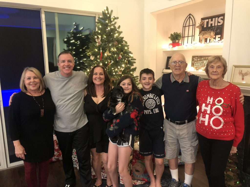Duncan Family in front of Christmas tree